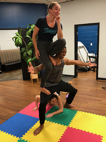 Acro Yoga - Sit on Shoulder Pose