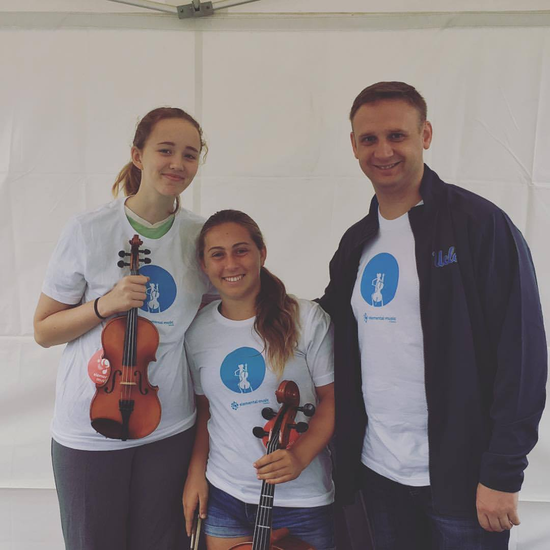 Elemental Music alumni volunteers at the Santa Monica COAST Festival with Elemental Strings Assistant Director Jason Aiello