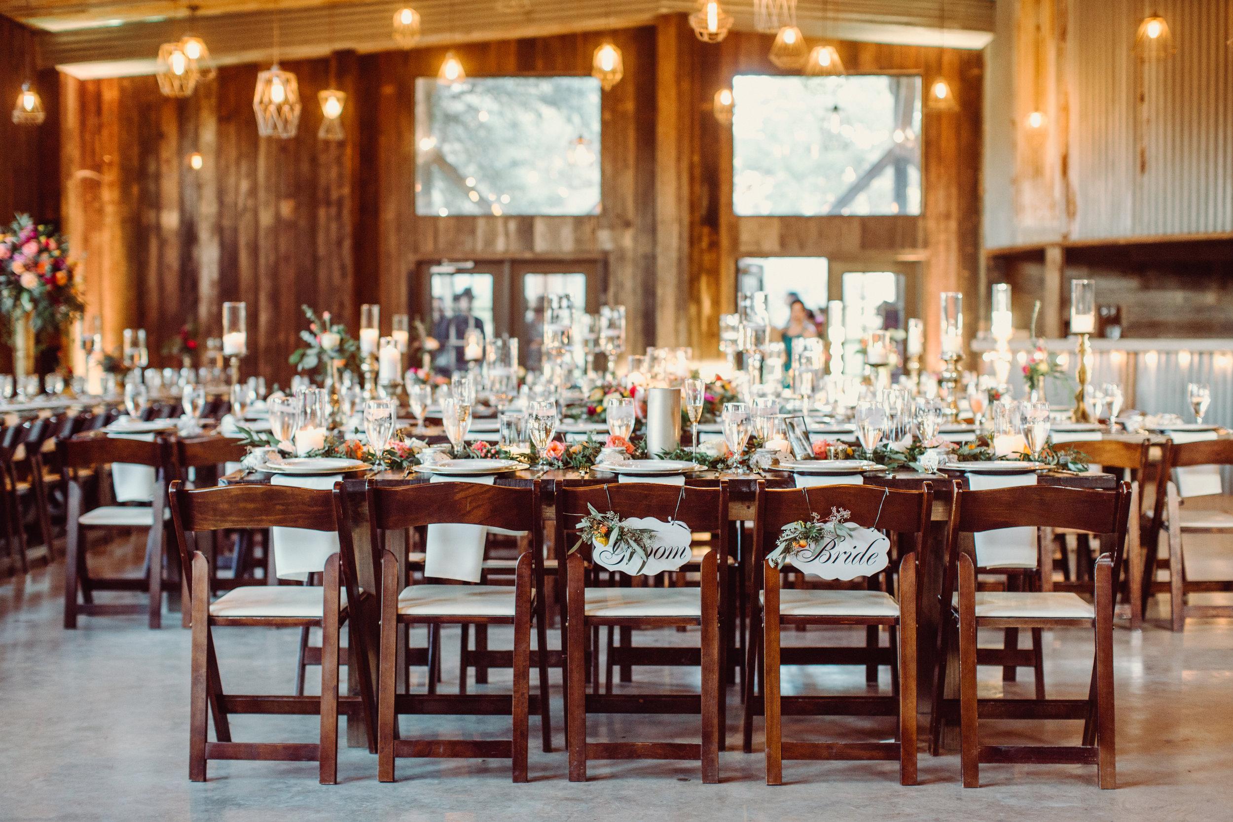 the-creek-haus-petal-pushers-reception-flowers-farm-table-fireplace-wedding-venue-vista-west-ranch