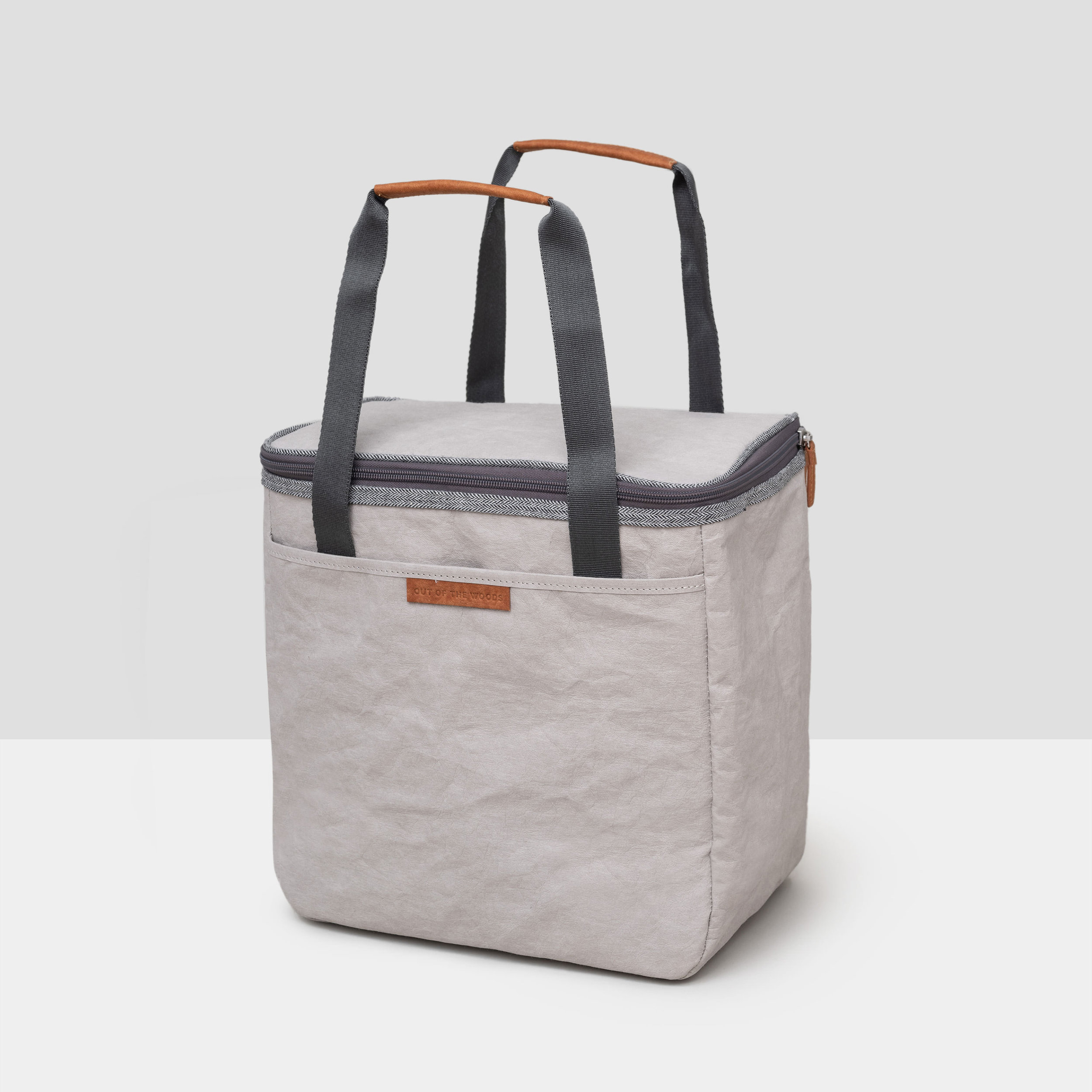 Dolphin Cooler in light gray Supernatural Paper with dark gray and herringbone trims.