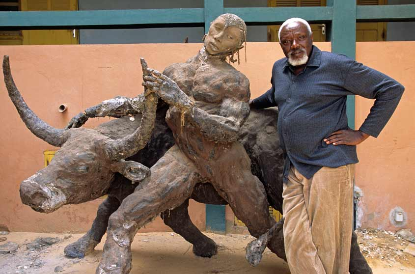 The late internationally acclaimed Senegalese sculptor Ousmane Sow with one of his works (Photo: Hemis/Alamy Stock Photo).