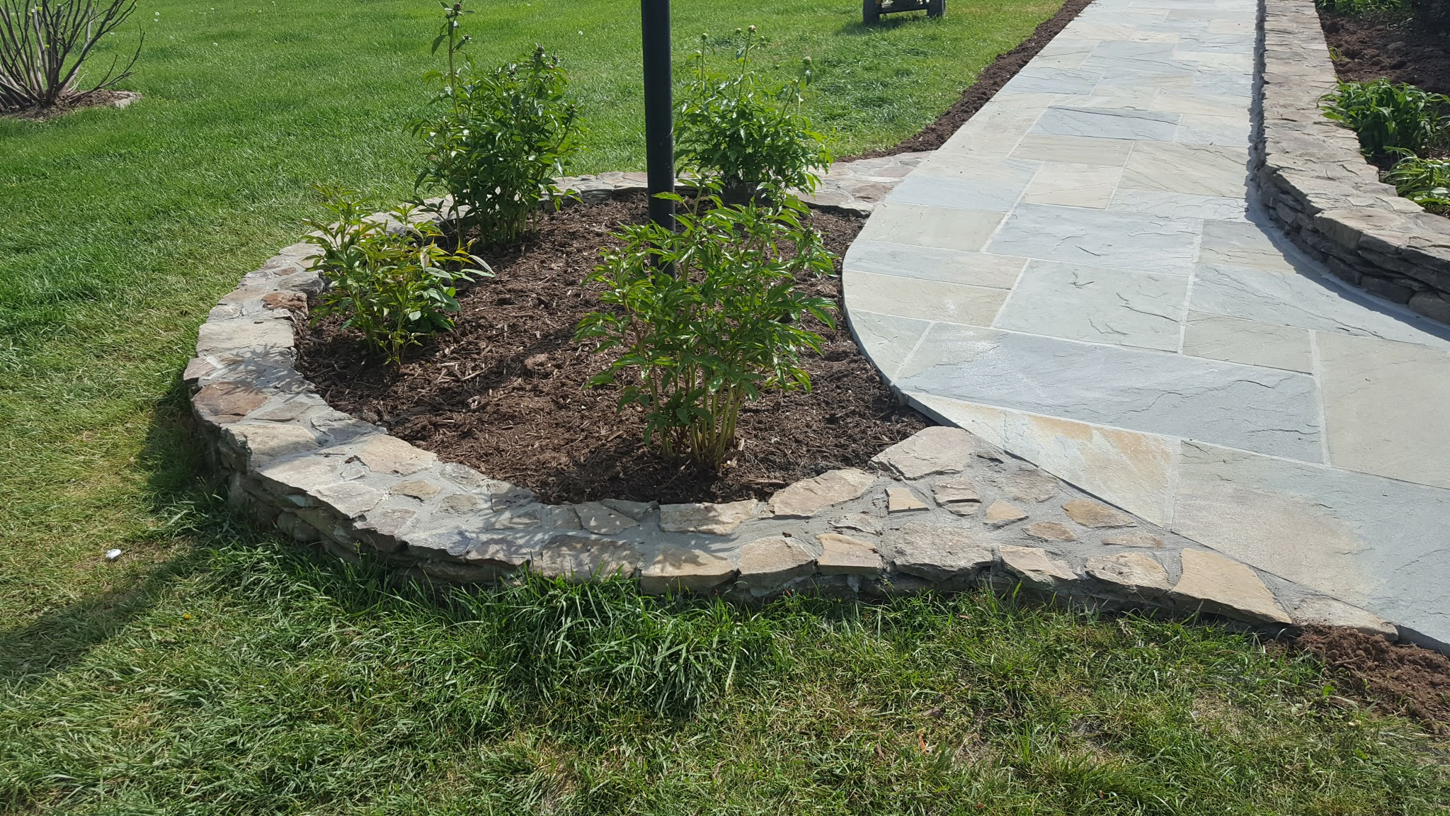 Fieldstone Garden Wall for a Lightpole.jpg