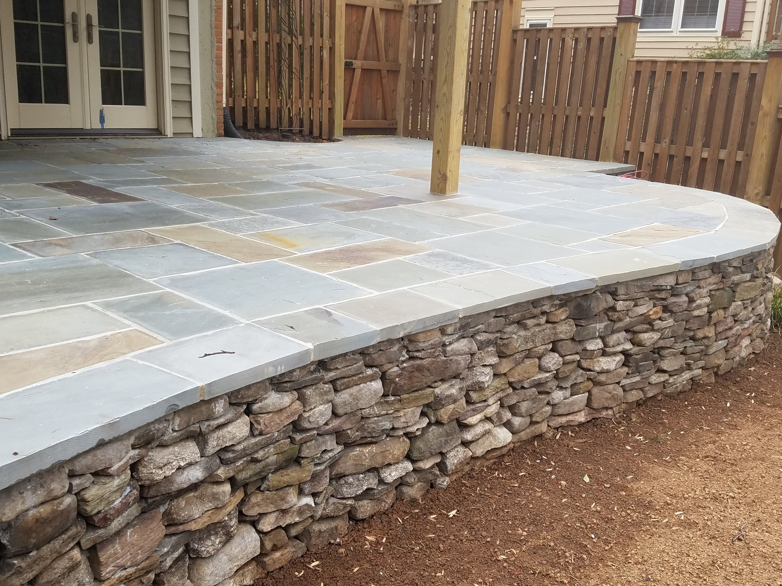 Flagstone Patio with Fieldstone Base Wall 4 .jpg