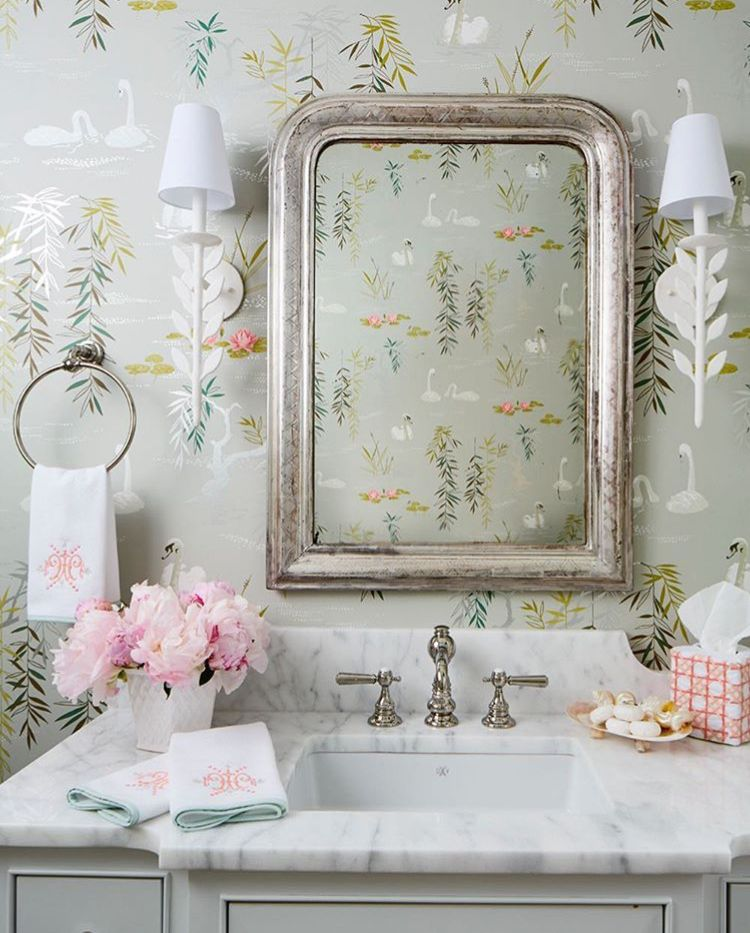 Powder Rooms With Style and Personality - Statement powder rooms are the jewels of a home. We love wallpapers and light fixtures that bring style and personality, like in this guest bath designed by Clary Bosbyshell, photographed by Heidi Harris for the Atlanta Show House.