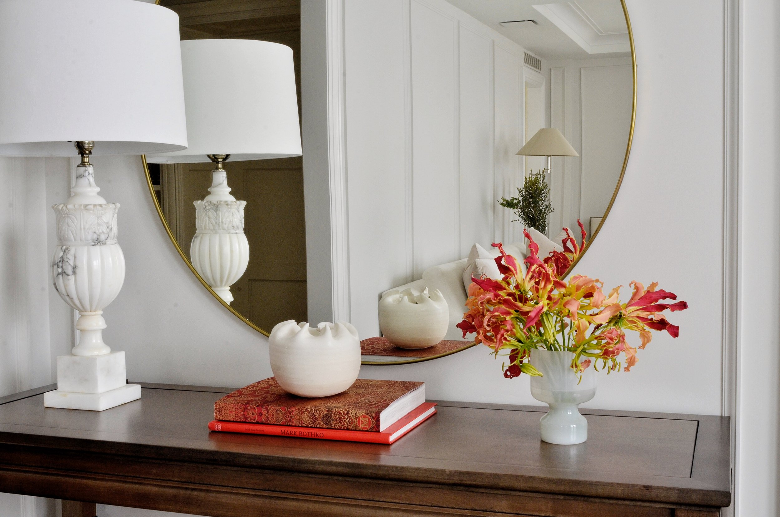 Console Styled with Gloriosa Lilies, designed by Born on Bowery.