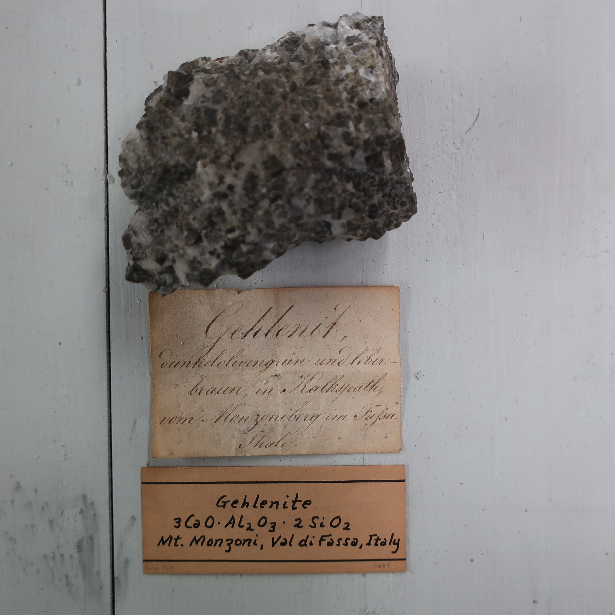 Gehlenite  is a combination of Silica 29, Alumina 24, Lime 35, Iron 6. It occurs in right square prisms and massive. It is usually grey, but frequently, has a greenish or yellowish tinge. Surface commonly rough and dull, it is found in the valley of Fassa, Tyrol.