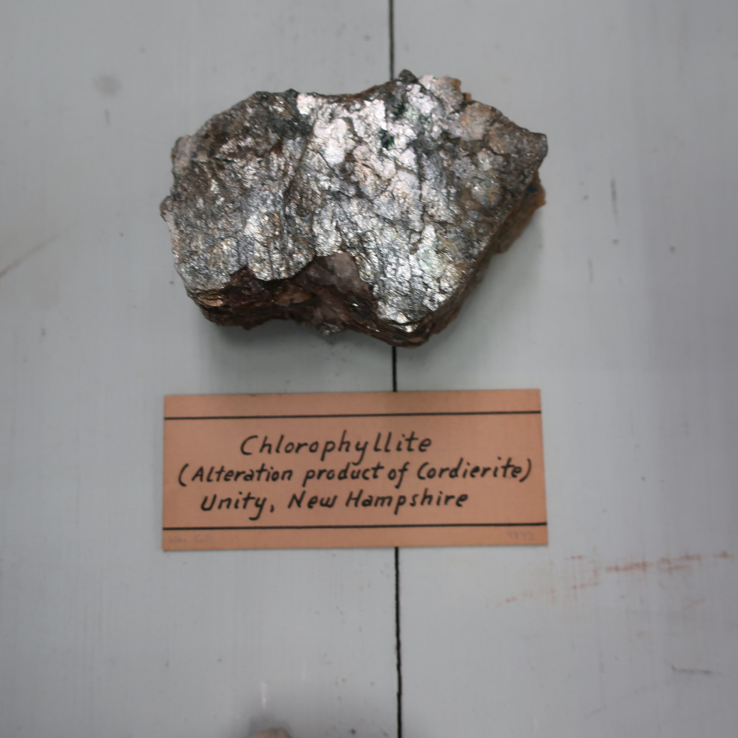 Chlorophillite  differs from [Diachoite] in hardness, Sp. Gr. and other physical properties, besides being a hydrated mineral. It has lately been found in the U.S. at Unity, New Hampshire, very plentifully crystallized. It consists of Silica 45, Alumina 30, Magnesia 9, Iron 5, Water 10. Sp Gr 2.07. Colour green, greenish brown, or dark olive brown. It occurs crystallized in six sided prisms. The specemens from Unity have the appearance of large foliated masses, they are divisible, the natural joints being filled by a magnesian mica, and imparts to them a talcy lustre. BB it is infusible alone.