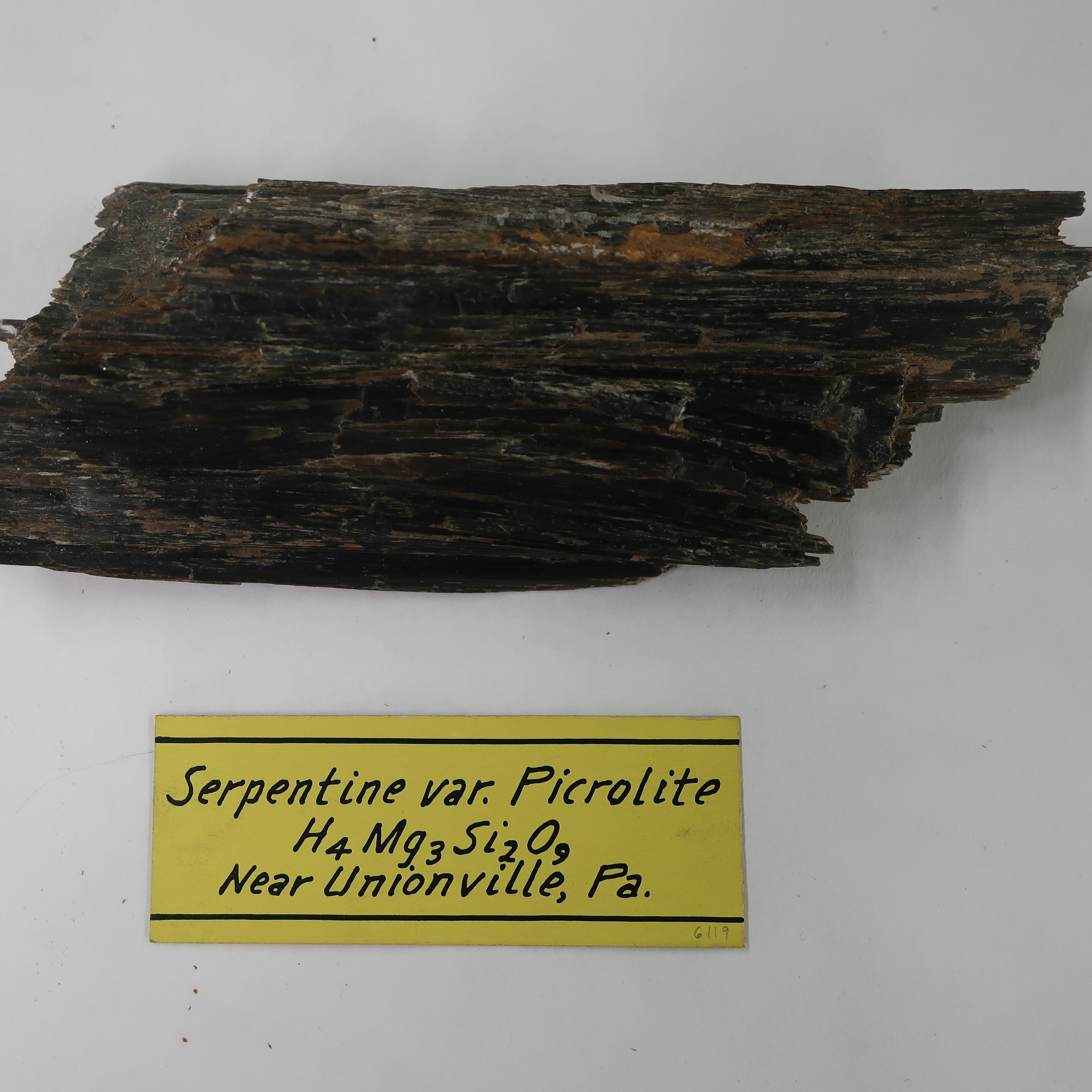 """Picrolite  must also be classed as a variety of [Serpentine]. It is massive or fibrous, with a radiated structure it is leek green, passing into yellow. It occurs in irregular veins in Sweeden, traversing veins of Iron ore, and associated with Calc spar, and serpentine."""