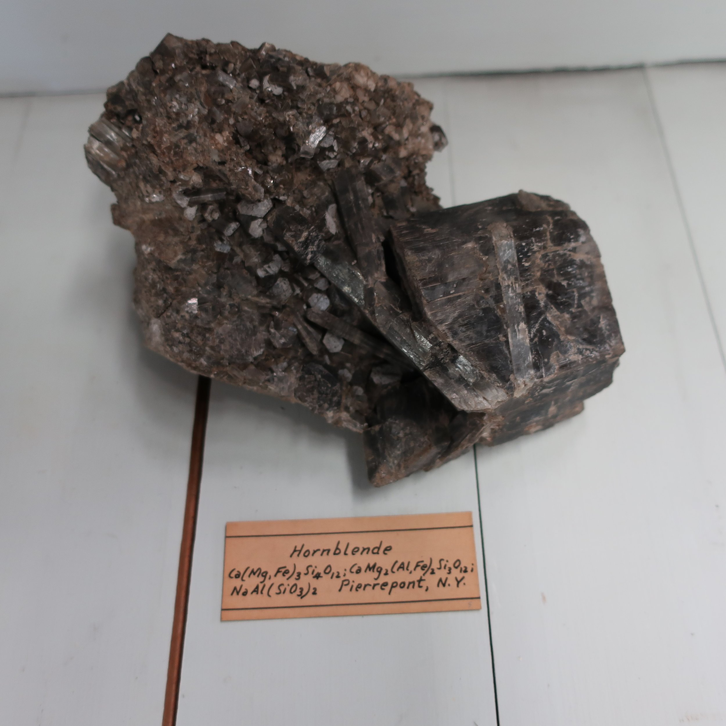 """Massive hornblende  has a crystalline structure, consisting of minute, and often of long crystals, intersecting each other, sometimes confusedly radiating. It is very tough, and difficult to break."""