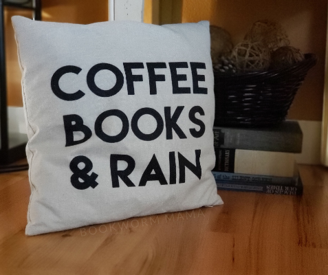 Coffee, Books, and Rain pillow with vintage books stacked as home decor.