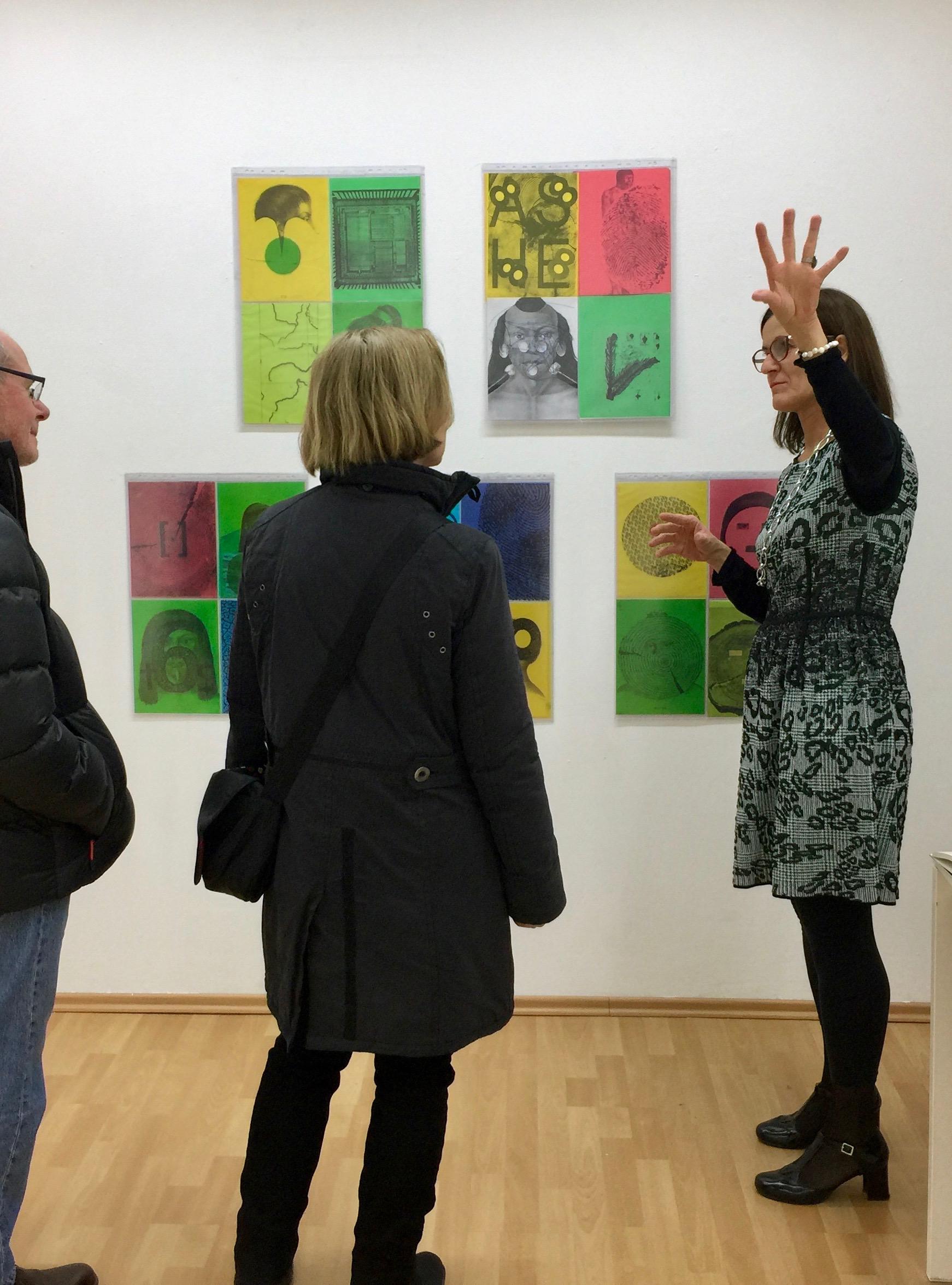 Curator Martina Merklinger showing the works of Cristina Barroso