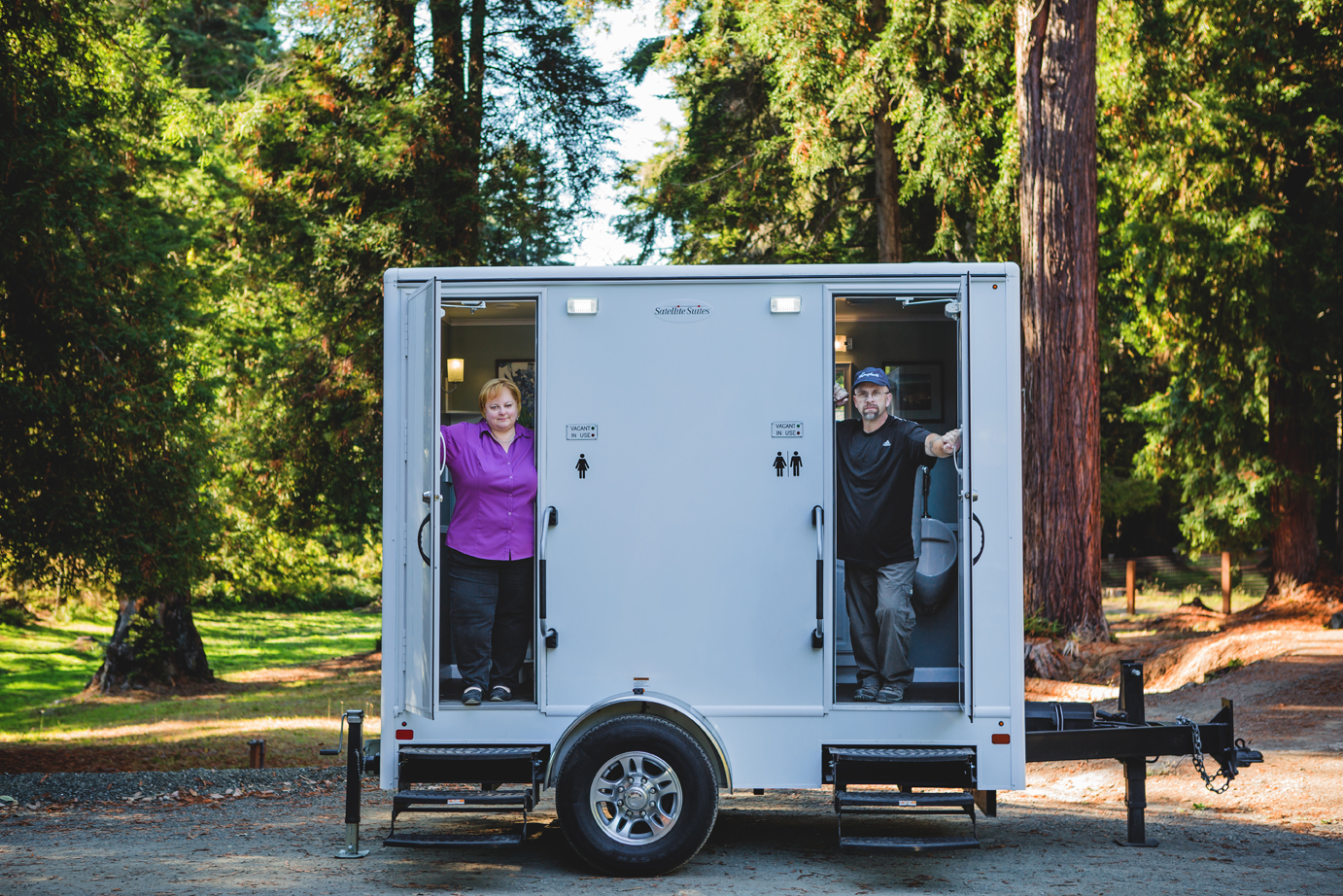 Kari Walsh and Robert Wegner show off their mobile relief station as part of their business, Porta Septic Service, located in Fort Bragg, CA.