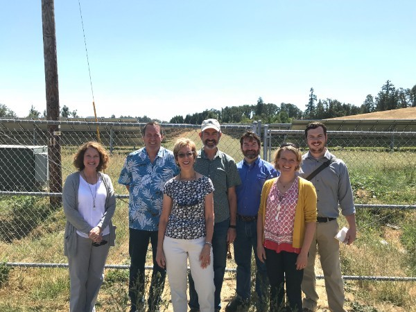 Janine Benner, ODOE director, and Robin Freeman, ODOE's government relations manager, gathered with Representatives Paul Holvey and Nancy Nathanson and her staff member James Ellsworth, Senator Floyd Prozanski, and Lane Electric general manager Matt Michel outside of Eugene last week to tour a solar project in Lane Electric's service area.
