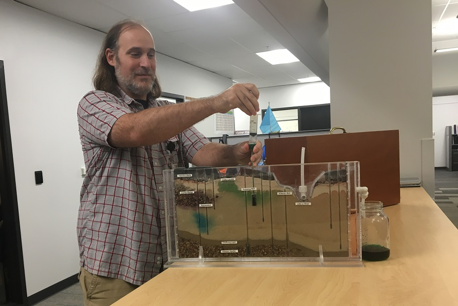 Tom also shows how pump-and-treat systems work. Using a pumping well, Tom extracts some of the contaminated water. At Hanford, pump-and-treat systems have made a lot of progress in groundwater cleanup.