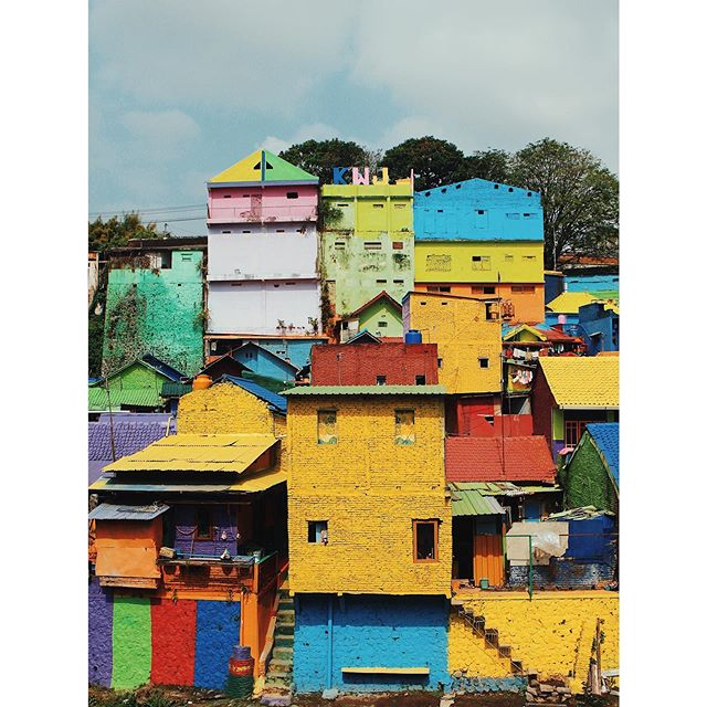 Kampung Pelangi (Rainbow Village), East Java, Indonesia. . In April 2017, this little hamlet was granted money from the Indonesian government for a community improvement programme. Within a month 232 houses were painted all colours of the rainbow 🌈 . The former slum has since seen a dramatic increase in tourism (understandably - it's quite a sight!), which has improved the local economy. What's more, the process of transformation pulled people into engaging in improving their community. . Every alleyway, staircase, & corrugated roof was splashed with colour & festooned with flags. . . . #indonesia #eastjava #java #rainbowvillage #exploreindonesia #bali #traveldeeper #thiscolourfullife  #somewheremagazine #exploreobserveshare #capturestreets #sidewalkerdaily #urbanjungle #streetphotography #thislifemagazine #stayandwander #travelphotography #lonelyplanet #passportable #worlderlust #travelersnotebook #theglobewanderer #justbackfrom #mytinyatlas #travelogue #thisisindonesia #wonderfulindonesia #inspiringwanderers #goexplore