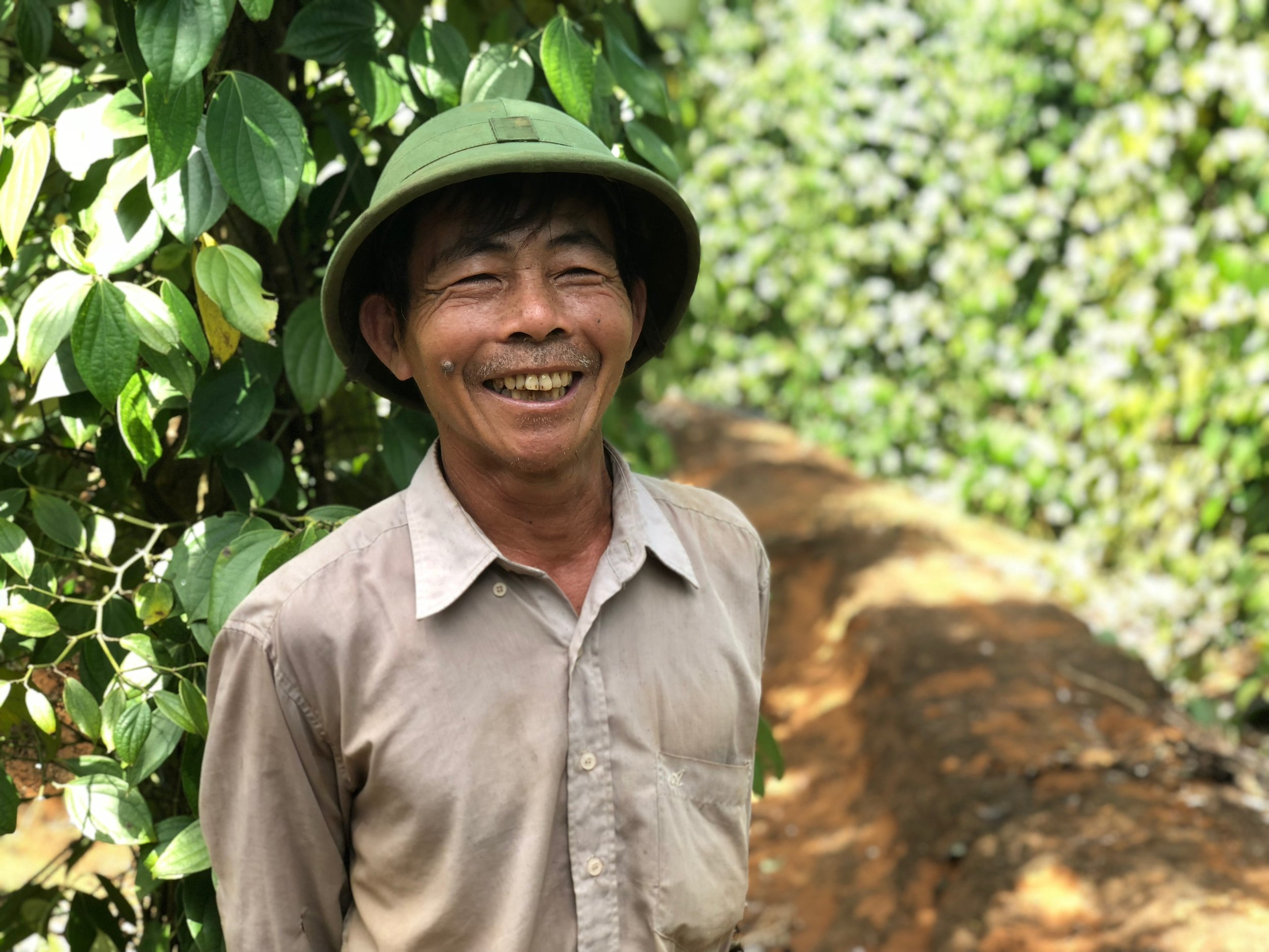 Roots-of-Peace-ROP-agriculture-Vietnam-farmer-black-pepper-smile.jpg