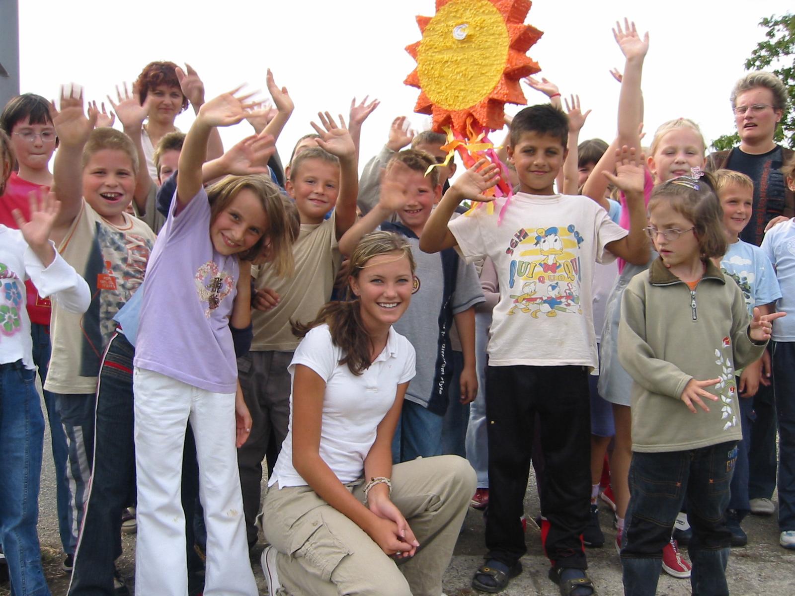 Croatia-children-school-pinata-Kyleigh-Kuhn-Roots-of-Peace-ROP-waving-kids-smiling.jpg