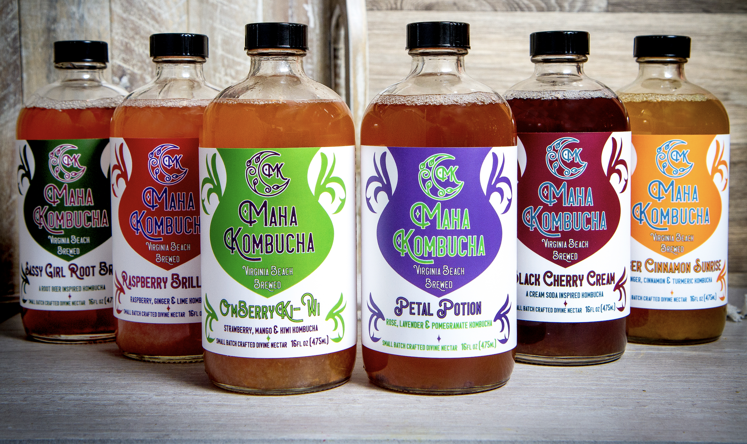 MAHA KOMBUCHA   Hi! Welcome to Maha Kombucha Co. We are a small business created and run right here in Virginia Beach by Mahadeva and Hari Dasi. We are founded under the philosophy of consciousness towards ourselves and our community. We strive to produce a beneficial local product while minimizing the environmental impact of production. We are proud to use only organic or wildcrafted ingredients, fair trade whenever possible, aiming for a zero-waste policy in our business and personal lives. We are yoga teachers, artists, linguists, creators and chefs hoping to share our spirit for life with you through Maha Kombucha and yoga. Please come meet us at the farmers' markets, join us for a yoga class or send us a message. We look forward to meeting you.