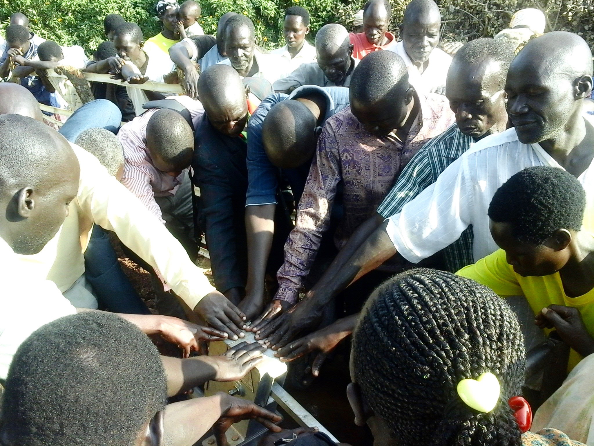 Praying over the borehole (2) 2.jpg
