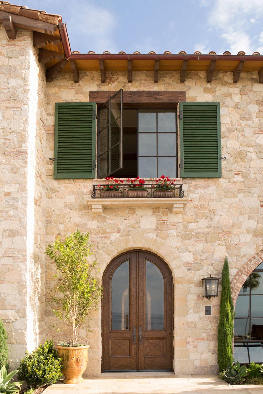 Tuscan-Mediterranean-House-Exterior-Entry-Wood-Front-Door-stone-Facade-corbin-reeves.jpg