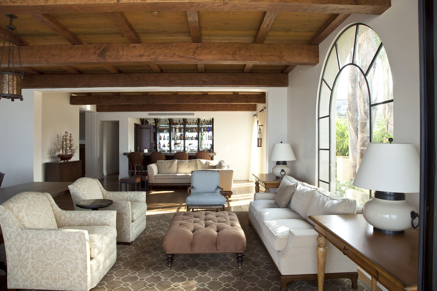 Contemporary-Spanish-Bar-Beamed-Tongue-Groove-Ceiling-Arched-Window-Corbin-Reeves.jpg