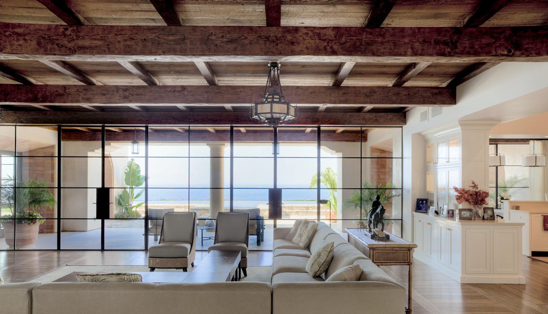 Contemporary-Spanish-Living-Room-Built-in-Shelving-Floor-Ceiling-Windows-French-Doors-Corbin-Reeves.jpg
