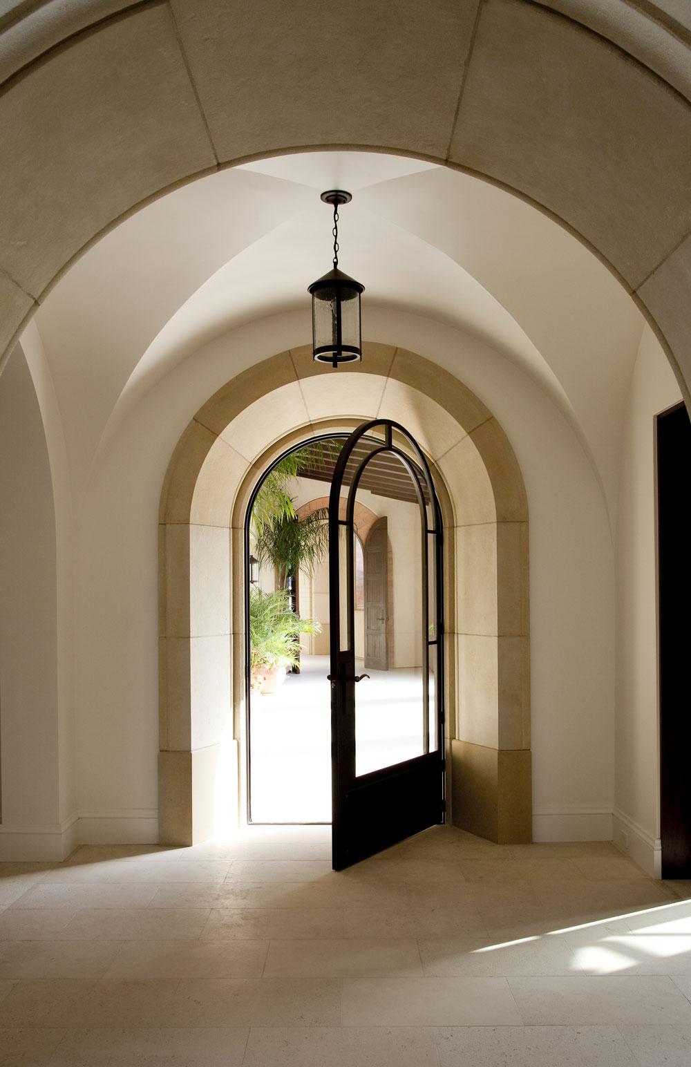 Modern-Spanish-Entryway-Cathedral-Ceiling-Arched-Doorway-Corbin-Reeves.jpg