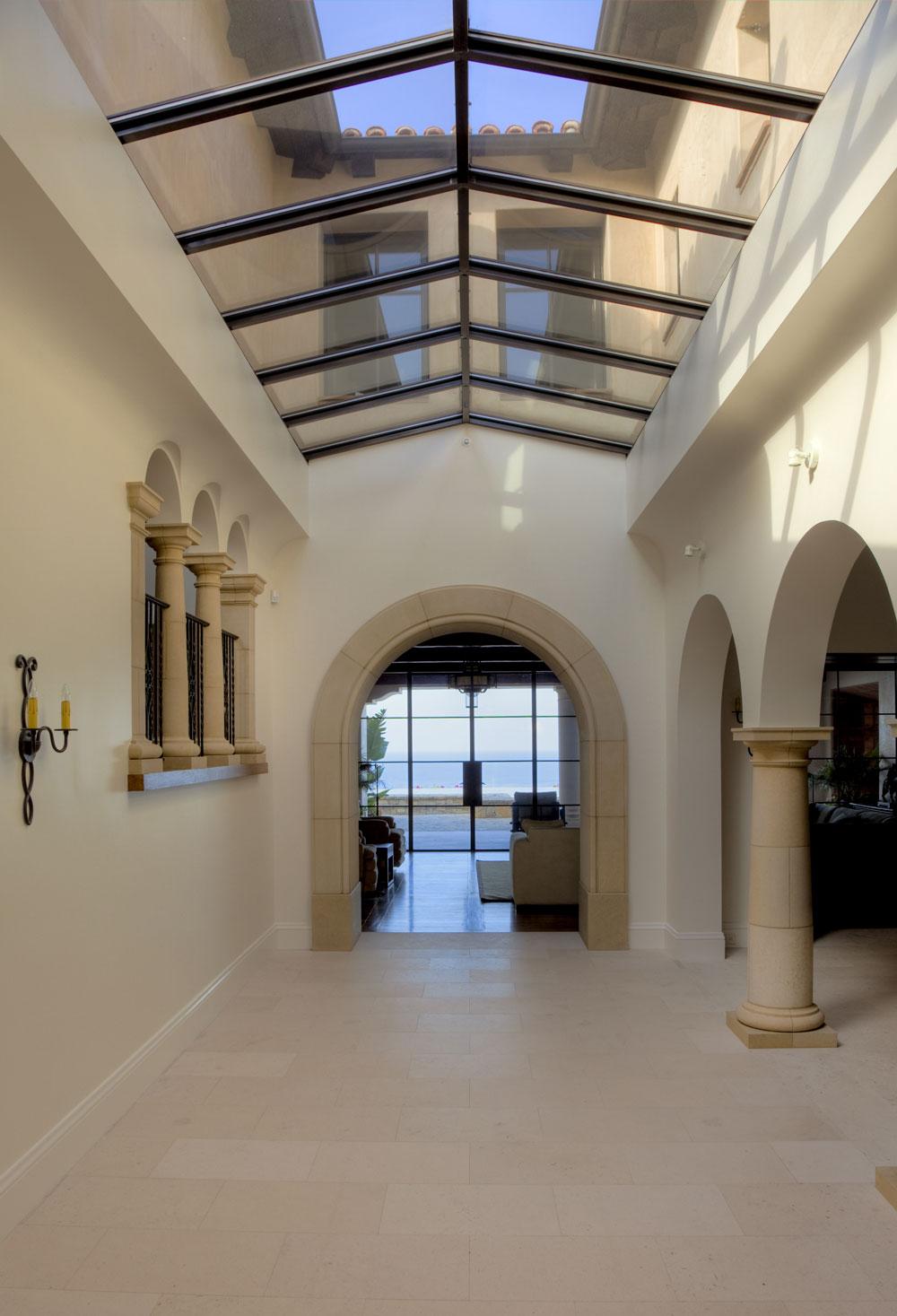 Modern-Spanish-Glass-Ceiling-Minimalist-Hallway-Stone-Archway-Corbin-Reeves.jpg
