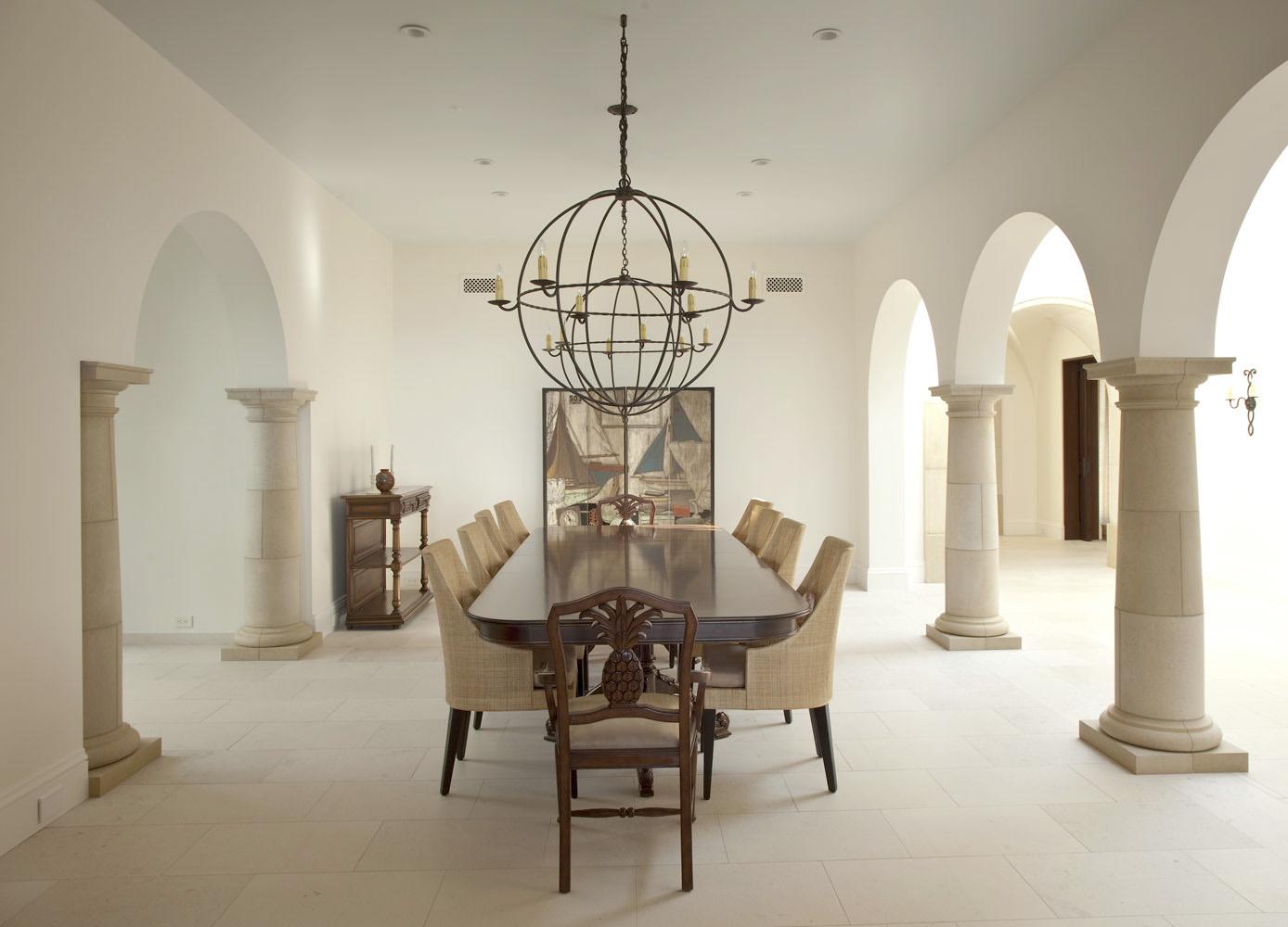 Modern-Spanish-Minimalist-Dining-Room-Archway-Stone-Columns-Corbin-Reeves.jpg