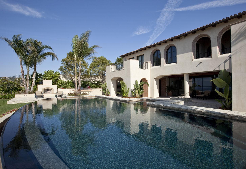 Modern-Spanish-Rear-Yard-Infinity-Pool-Outdoor-Fireplace-Patio-Corbin-Reeves.jpg