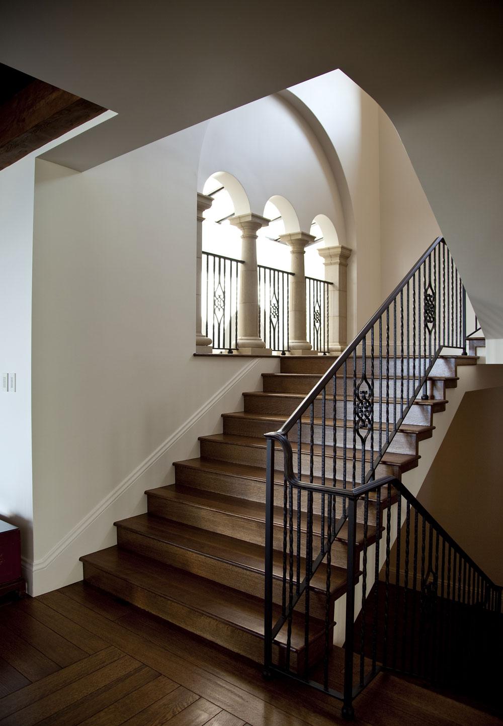 Modern-Spanish-Wood-Floor-Staircase-Wrought-Iron-Railing-Arched-Windows-Corbin-Reeves.jpg