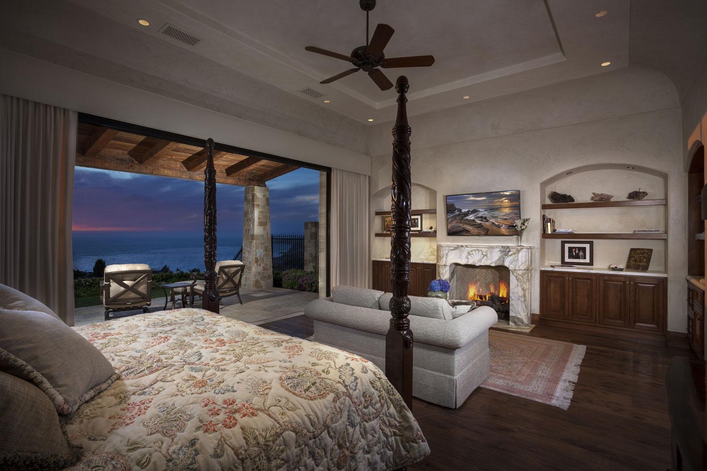 Master-Bedroom-Fireplace-Retractable-Doors-Private-Patio-Corbin-Reeves.jpg