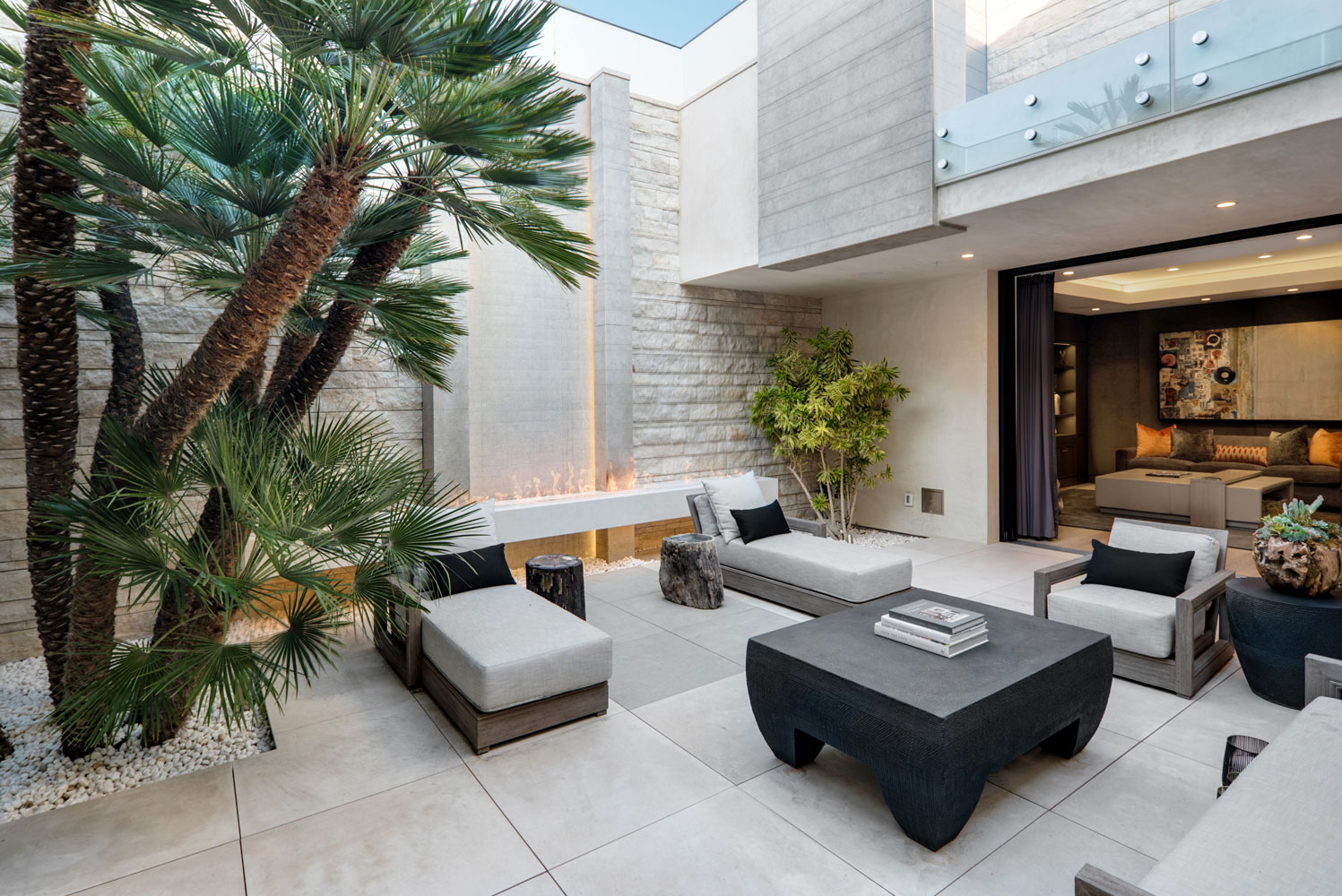 Contemporary-Courtyard-Outdoor-Firepit-Retractable-Doors-Hardscaping-Corbin-Reeves.jpg