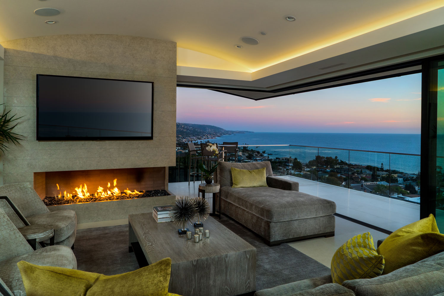 Contemporary-Living-Room-Fireplace-Retractable-Doors-Ocean-Views-Corbin-Reeves.jpg