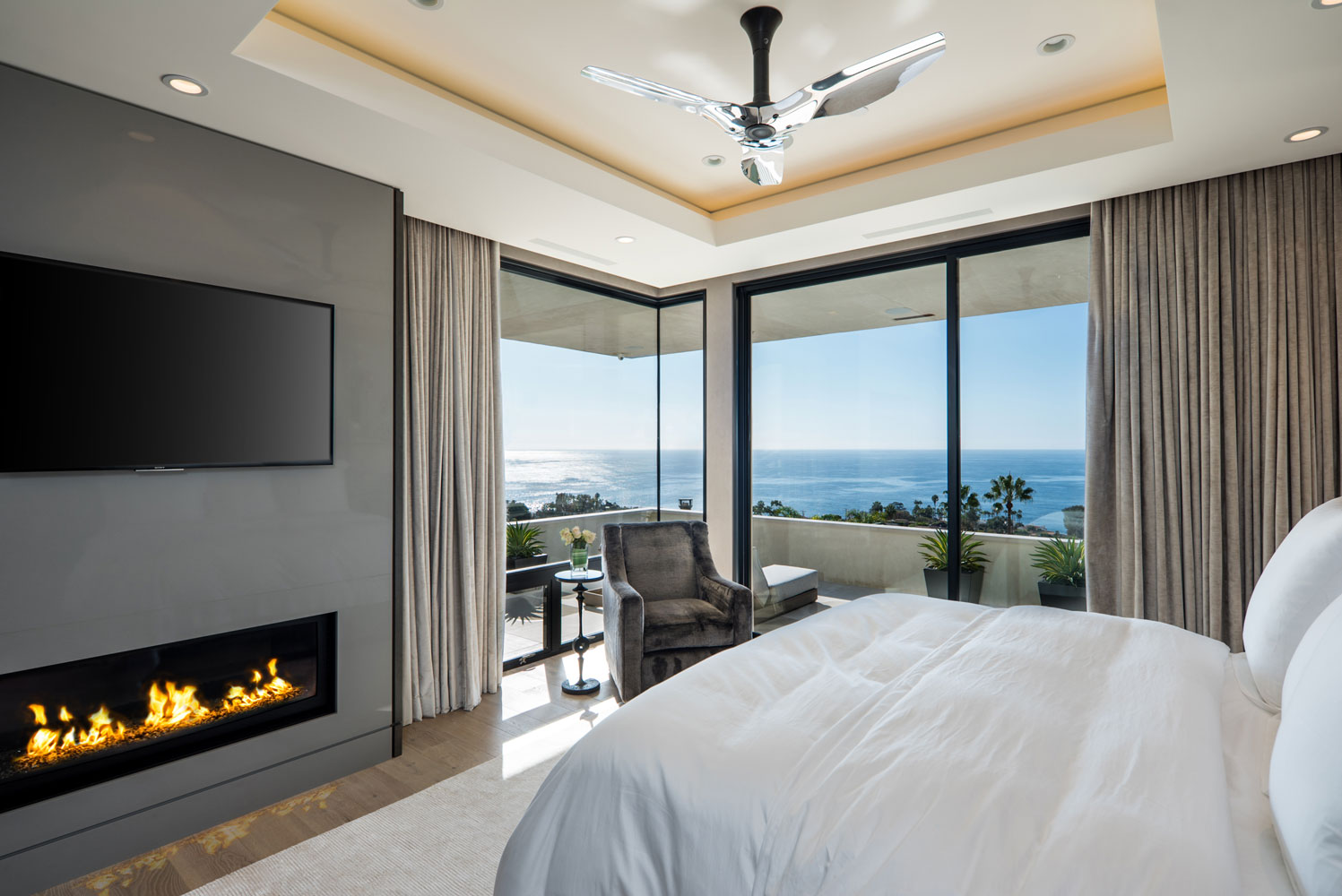Contemporary-Master-Bedroom-Fireplace-Ocean-Views-Corbin-Reeves.jpg