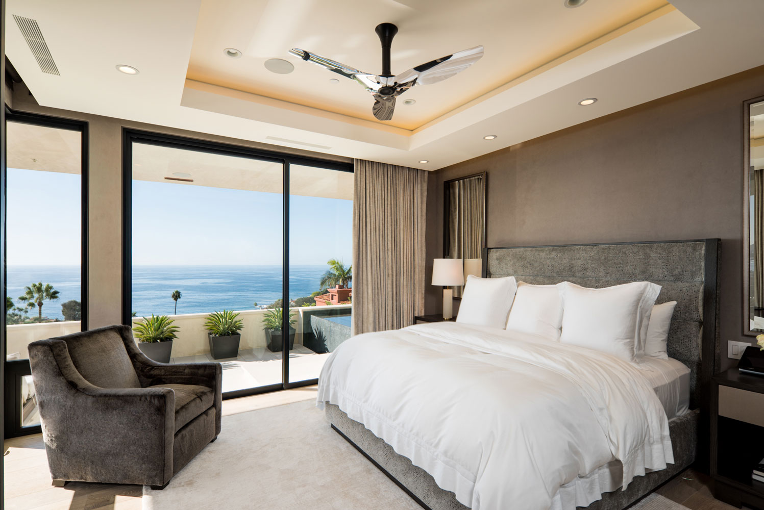 Contemporary-Master-Bedroom-Steel-Sliders-Chrome-Ceiling-Fan-Corbin-Reeves.jpg