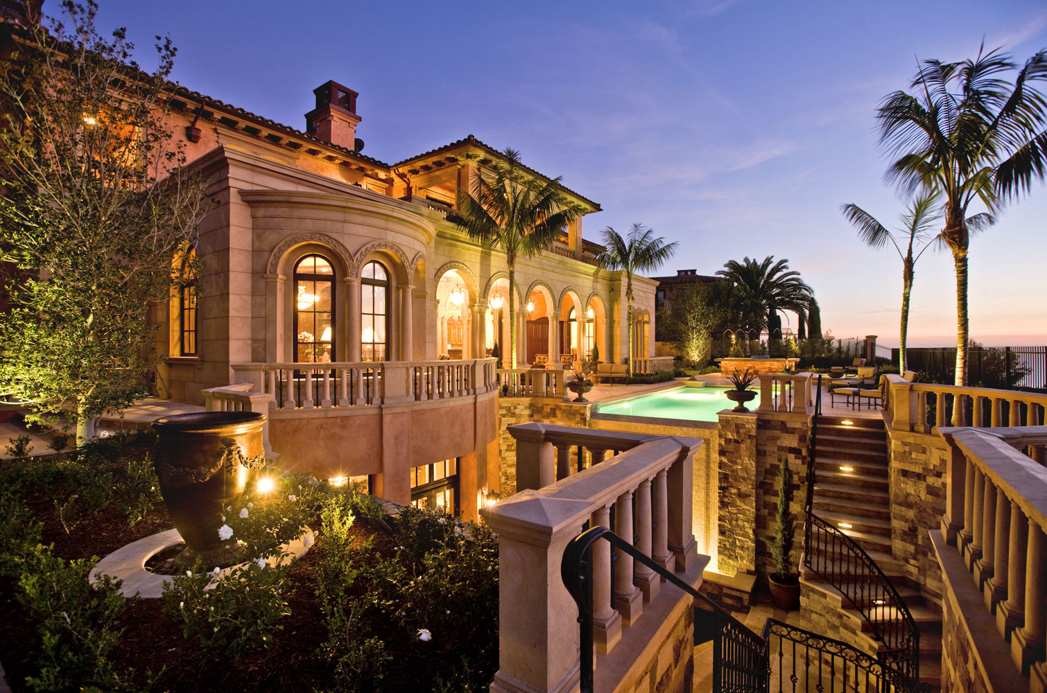 Contemporary-Italianate-Rear-Exterior-Columns-Archways-Pool-Corbin-Reeves.jpg