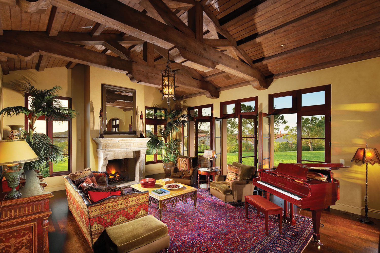 Contemporary-Spanish-Living-Room-Beamed-Trussed-Ceiling-Fireplace-Corbin-Reeves.jpg