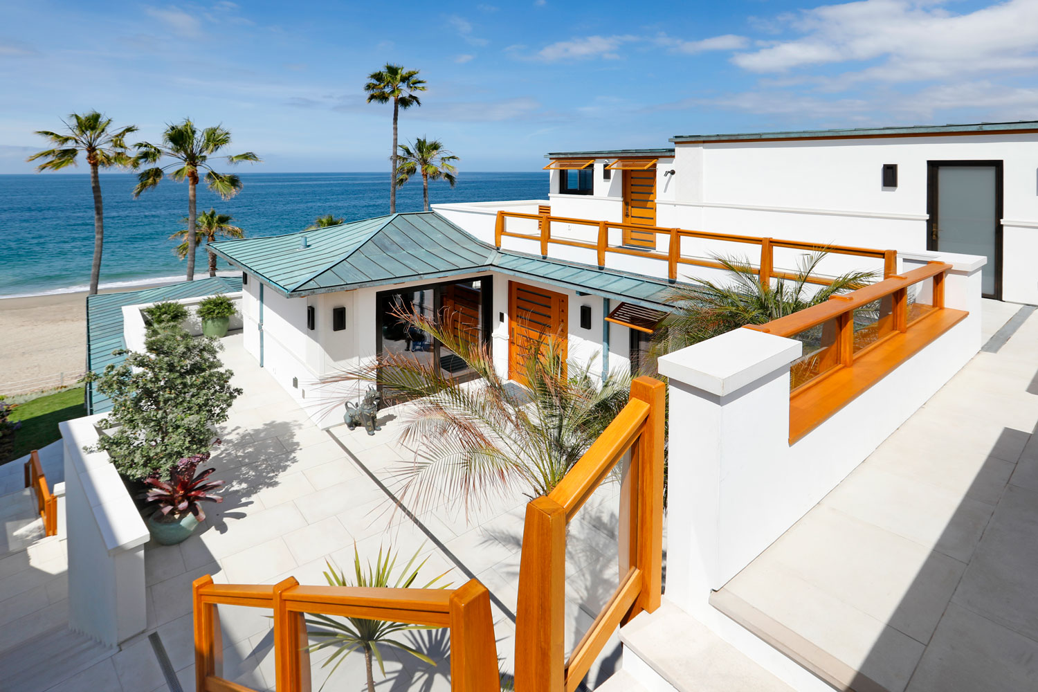 2-Contemporary-Beach-House-Patio-Copper-Roof-Patina-Corbin-Reeves.jpg