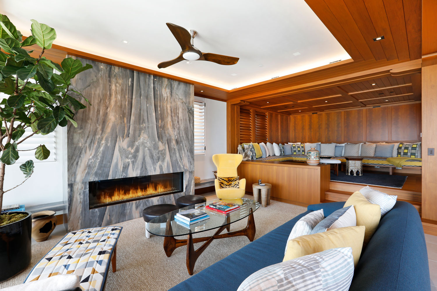 6-Contemporary-Living-Room-Marble-Fireplace-Wood-Paneling-Corbin-Reeves.jpg