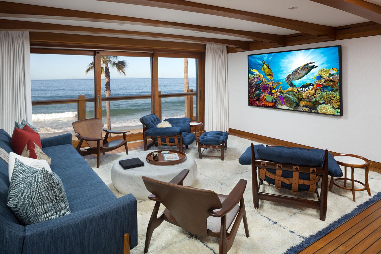 18-Media-Room-Beach-House-Beamed-Ceiling-Retractable-Doors-Corbin-Reeves.jpg