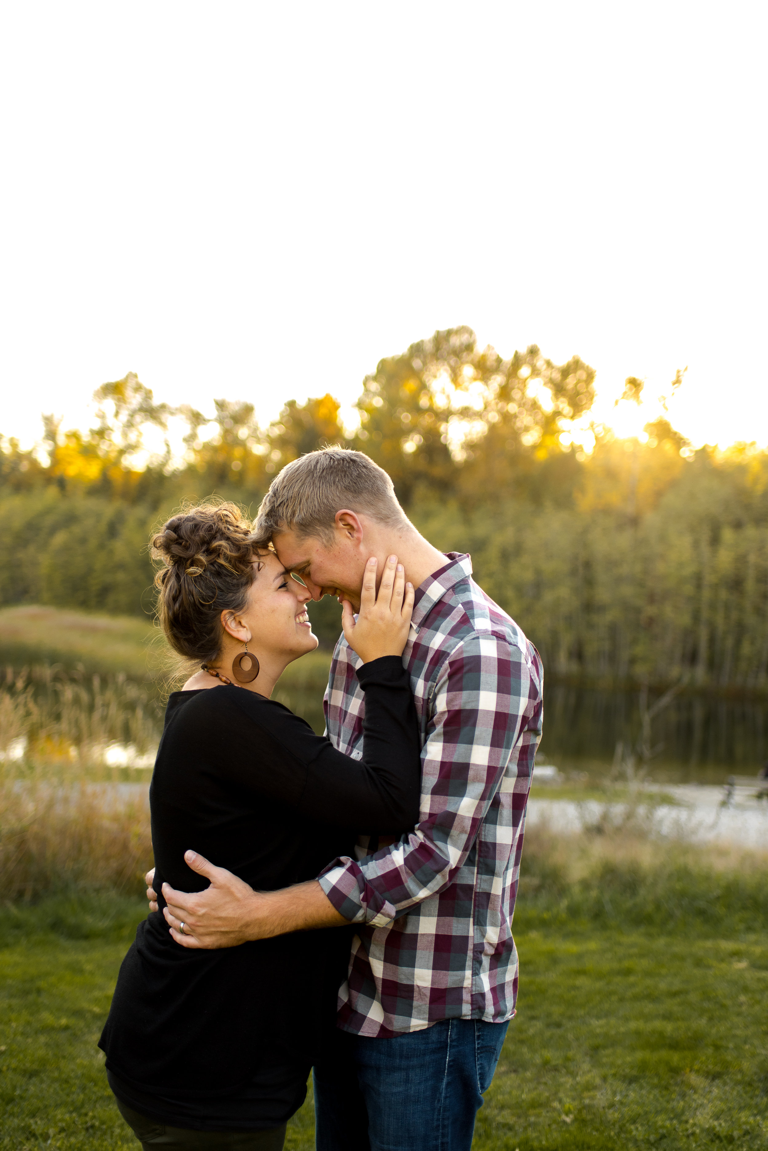Couple hugging during their family session in Green Timbers Park in Surrey BC