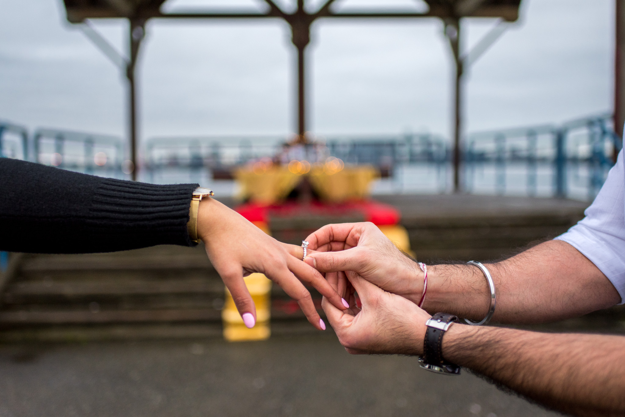 Engagement ring is put on a finger in North Vancouver BC