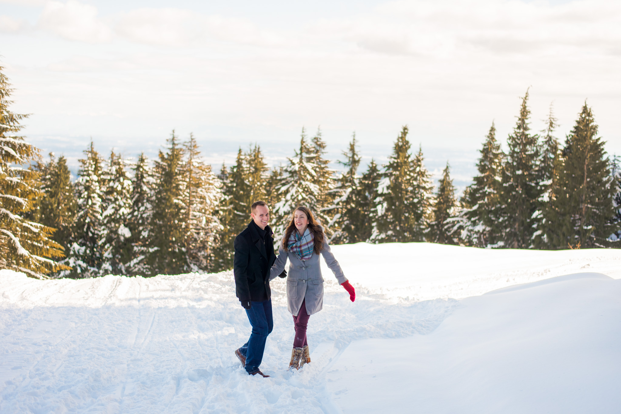Couple spending time in the snow on top of Mount Seymour
