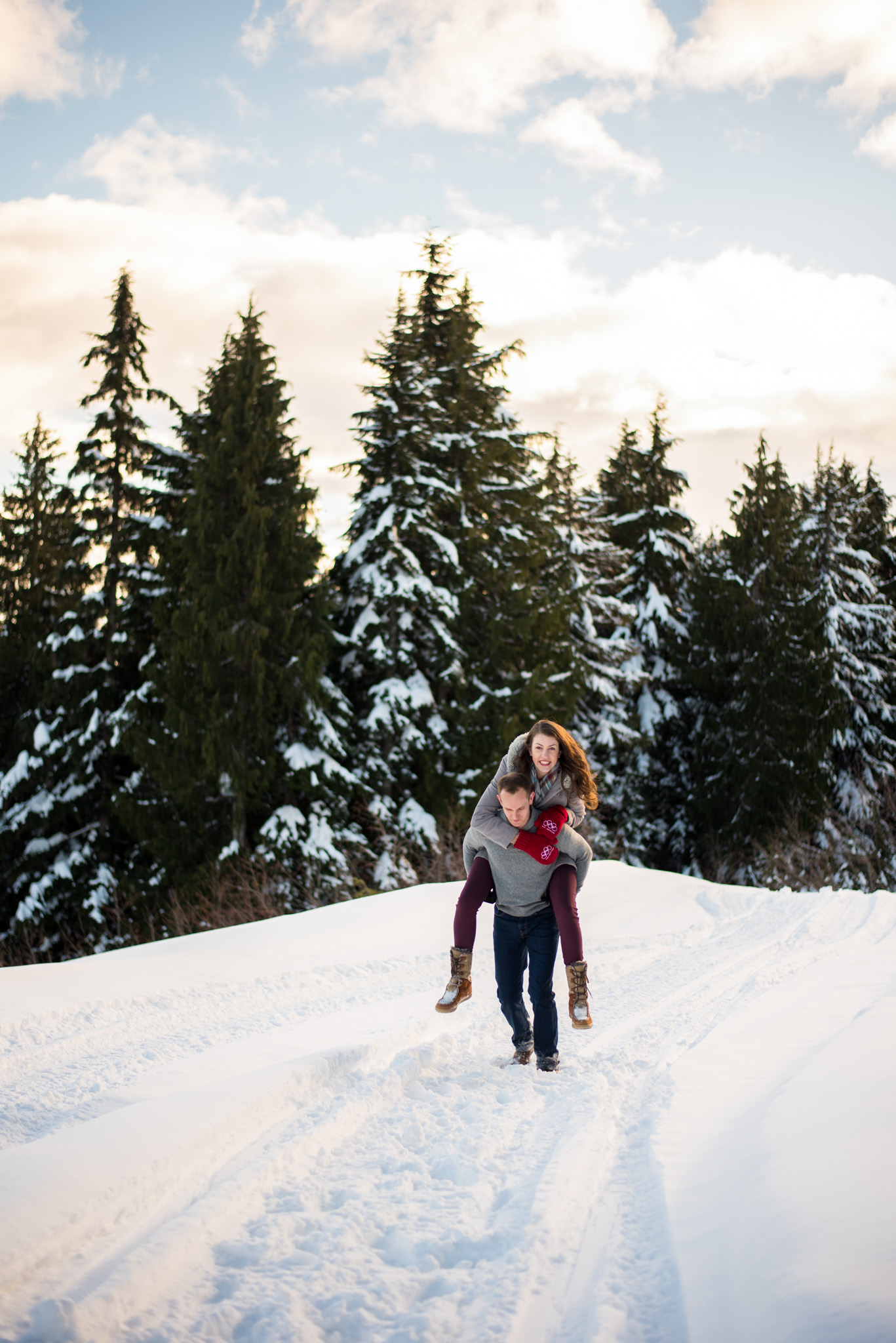 Couple does a piggyback ride in Mount Seymour in Vancouver BC