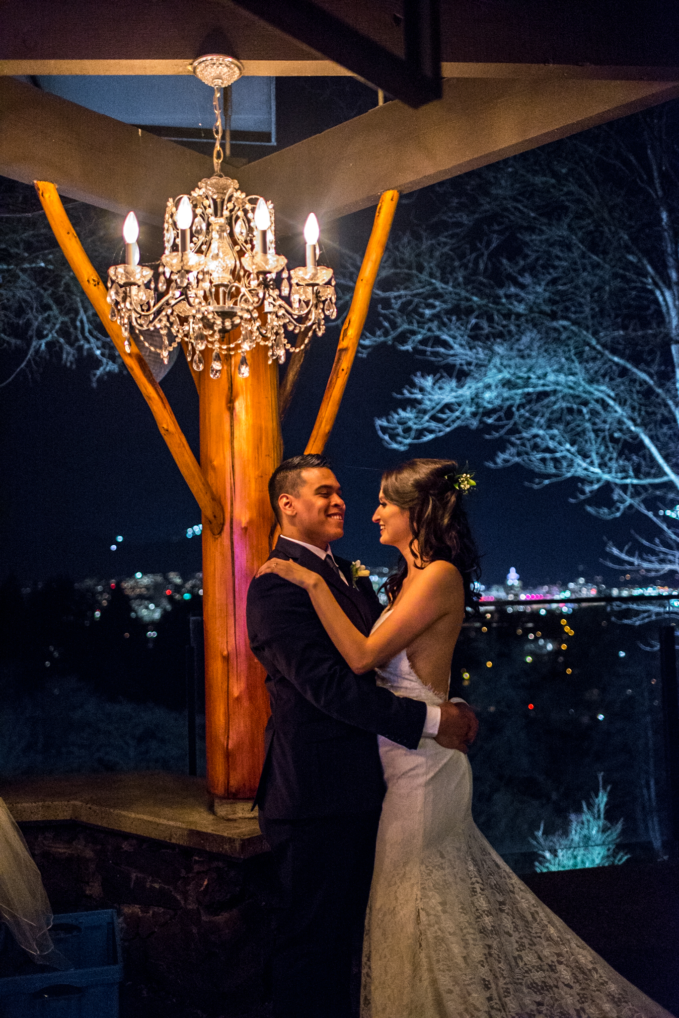 Bride and Groom underneath a chandelier at Seasons Restaurant at Queen Elizabeth Park