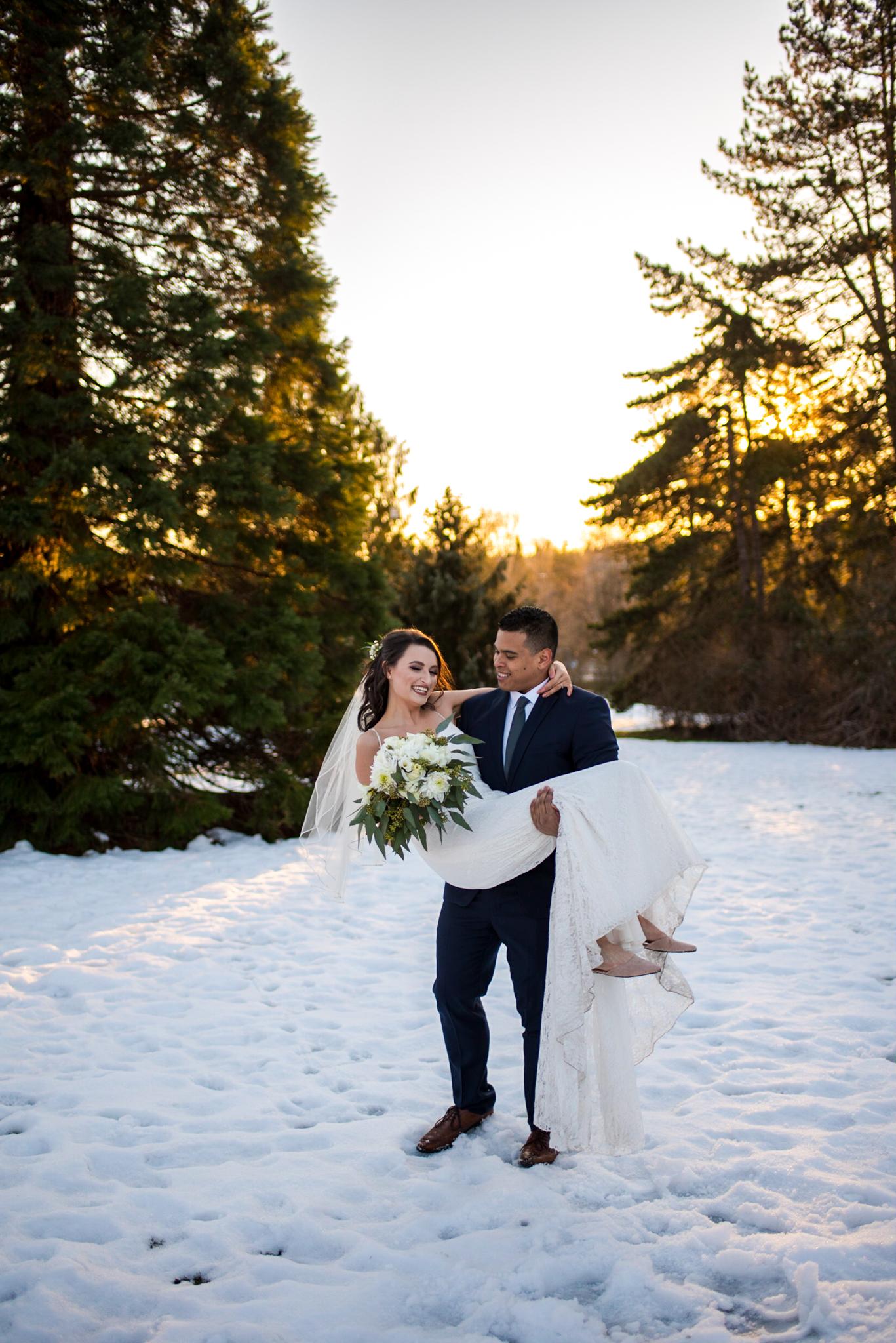 Bride and Groom in the snow at Queen Elizabeth Park
