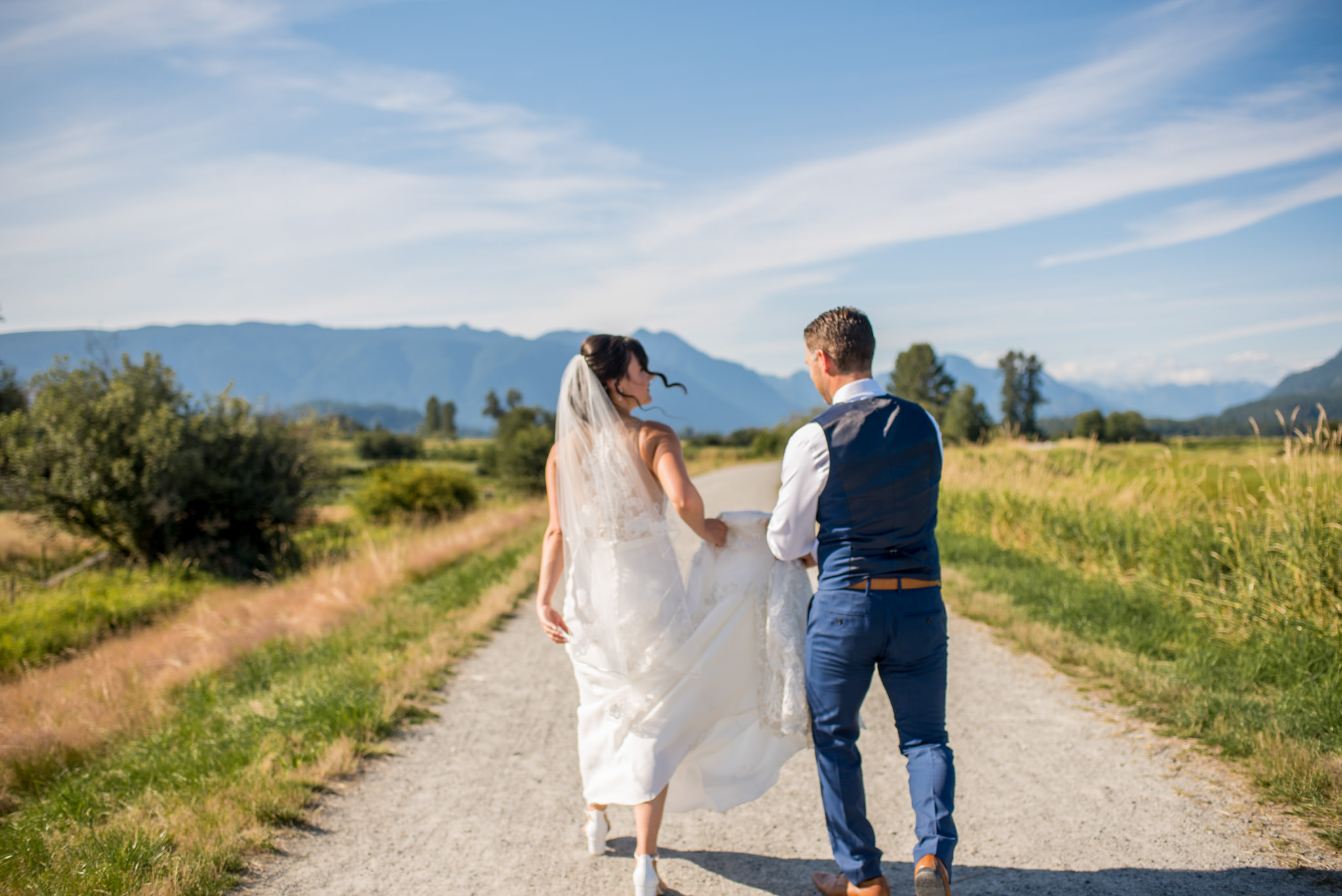 Bride and Groom walking in Jerry Sulina Park, Maple Ridge, BC