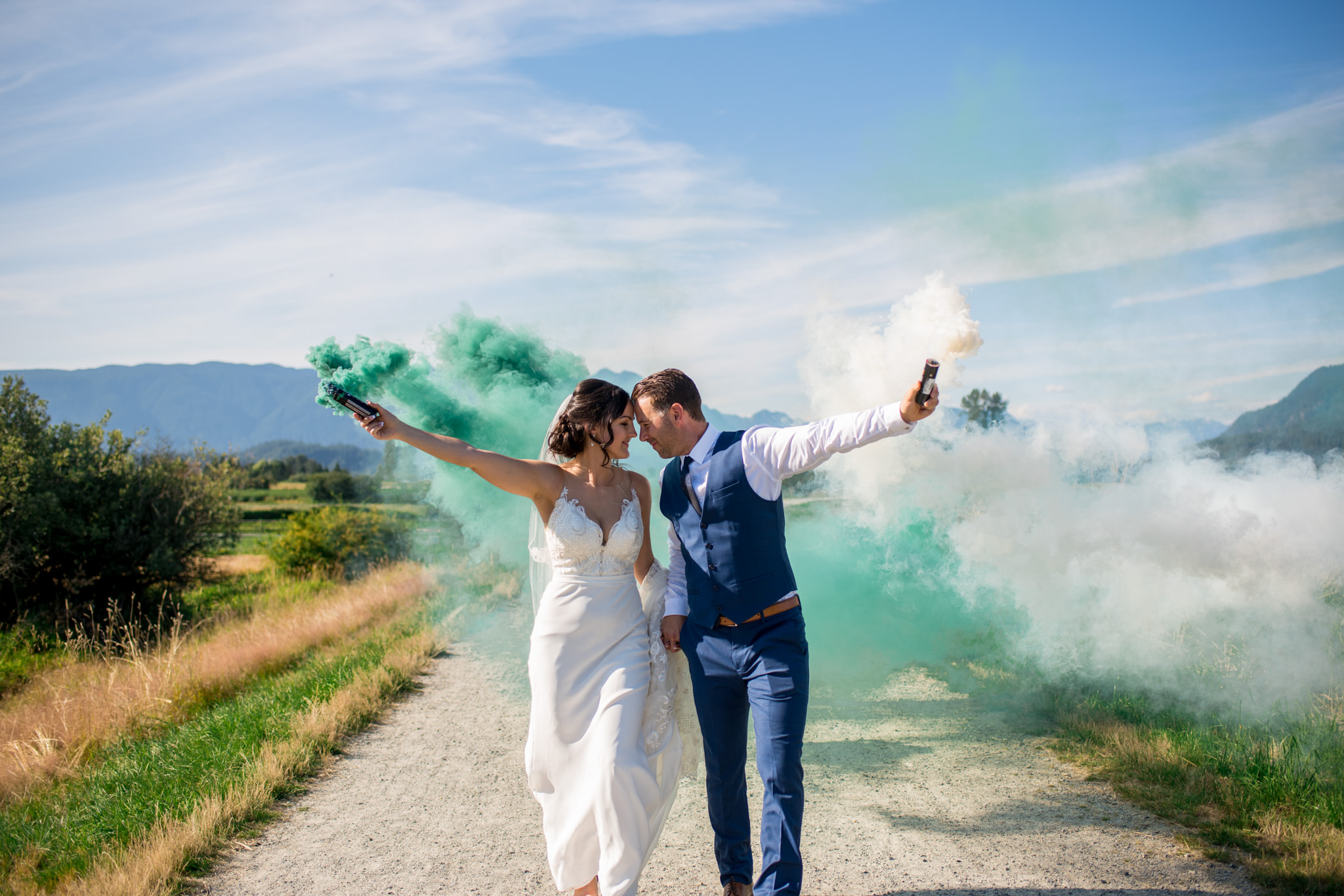 Wedding Couple with smoke bombs walking in Jerry Sulina Park, Maple Ridge BC