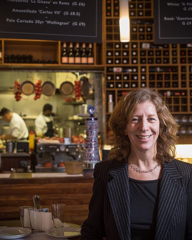 Monika has been at the helm of @brindisaspanishfoods for more than 30 years. She studied Spanish and lived in Spain for a little while afterwards teaching the language. After returning to London, she wanted to maintain a tie to the country she loved and began importing artisanal cheeses, sausages, and other Catalan delicacies that were relatively unknown in the 80s. By creating awareness of these foods, Monika was able to create demand for them as well, and she's regarded as being pivotal in bringing the tapas concept to Britain. . In 1996 she opened the Brindisa shop in Borough Market, way before it was on the tourist map, and in 2004 she converted a nearby potato warehouse into the group's first restaurant. Monika remains very much hands-on in the business today, splitting her time between the restaurant and the wholesale side of things. It's clear her passion for Spanish cuisine has never waned; her face lights up as she tells me about a cheese that comes from a tiny farm on Menorca with just 8 cattle.  More on Monika on the website soon! . — Long Service: London is a photography project about London's restaurants and cafes and their longest-serving members of staff, with a view to becoming a coffee table book at some point. The response has been fantastic so far and many venues are willing to be involved. I'll be posting some of the final portraits, details, exteriors, and behind the scenes images from the project over the coming weeks. — . Please follow, share, spread the word and get in touch if you'd like to be involved! longservicelondon.com